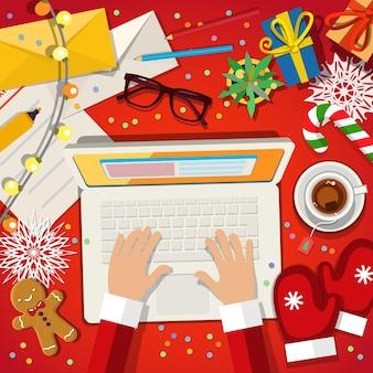 Weihnachtsmann, der an einer flachen designillustration des laptops arbeitet