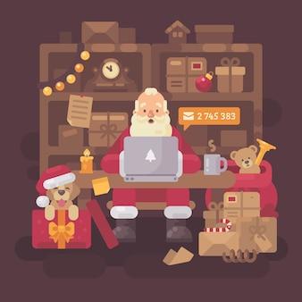 Weihnachtsmann, der e-mail auf einem laptop überprüft