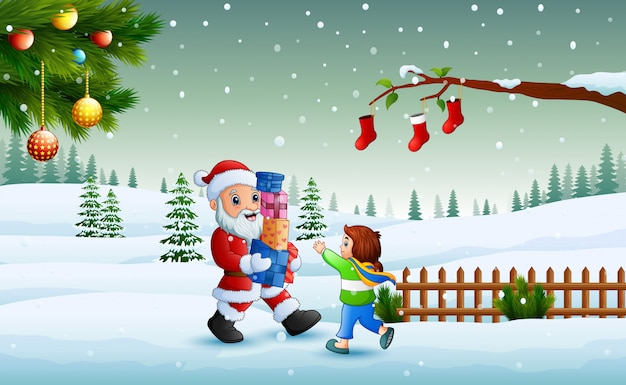 Weihnachtsmann, der ein kästen geschenk und ein kleines mädchen im winter hält