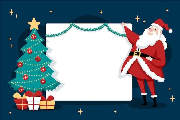 Weihnachtsmann hält ein leeres banner