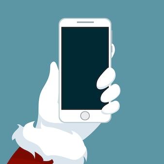 Weihnachtsmann-hand, die mobiltelefon hält