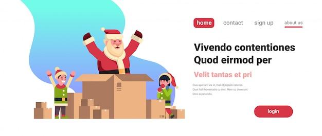 Weihnachtsmann innerhalb des papierkastens im weihnachtskonzeptelfenhelferjungen-mädchencharakter
