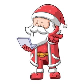 Weihnachtsmann kostüm und er hält einen kleinen laptop
