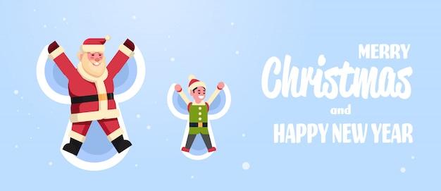Weihnachtsmann mit dem elfen, der draufsicht des schneeengels in weihnachten c macht