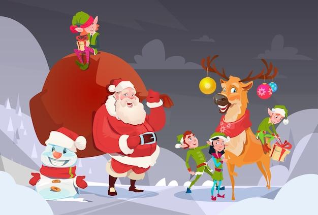 Weihnachtsmann mit ren-elfen