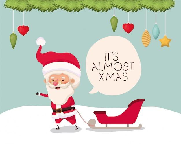 Weihnachtsmann mit wagen in der schneelandschaft