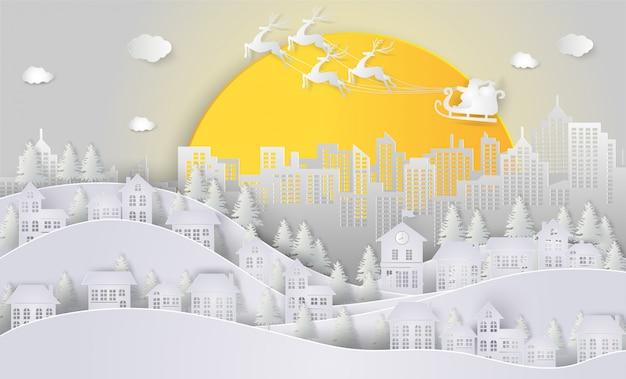 Weihnachtsmann und ren auf dem himmel und dem großen mond, die zur stadt kommen.
