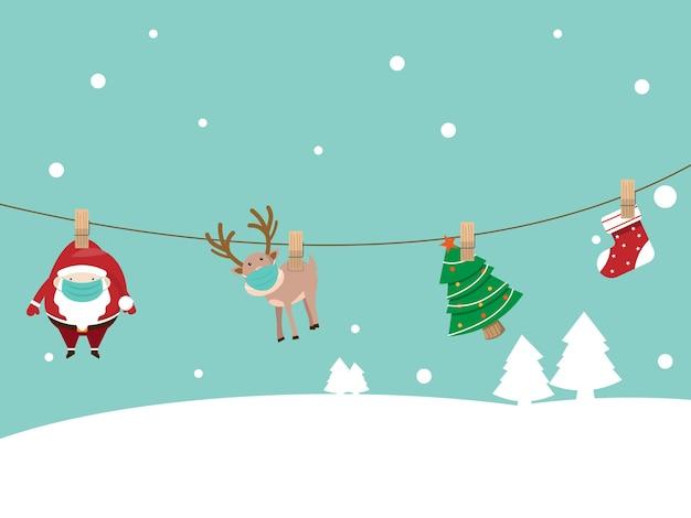 Weihnachtsmann und rentier tragen chirurgische maske, die mit sozialer distanzierung an robe hängt