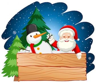 Weihnachtsmann und Schneemann mit Holzbrett