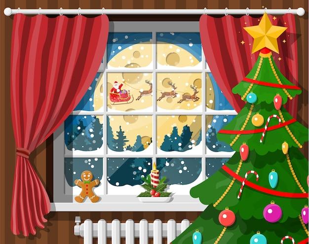 Weihnachtsmann und sein rentier im fenster. innenraum des raumes mit weihnachtsbaum. frohes neues jahr dekoration. frohe weihnachten. neujahrs- und weihnachtsfeier.