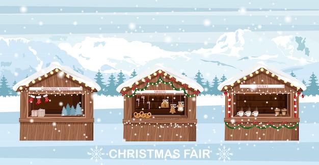 Weihnachtsmarkt steht mit süßigkeiten und getränken
