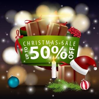 Weihnachtsmoderne fahne mit geschenken und santa claus-hut