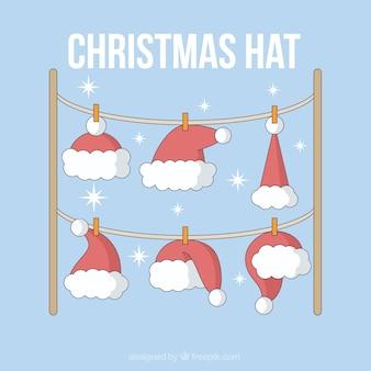 Weihnachtsmützen hängt an einem seil