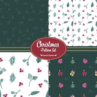 Weihnachtsmuster eingestellt. handgezeichnete kritzeleien. blumenmotive und weihnachtsschmuck