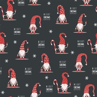 Weihnachtsmuster mit gnomen in roten hüten. süße skandinavische elfen.