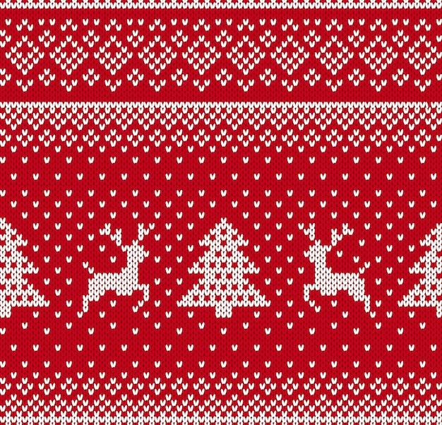 Weihnachtsmuster mit hirsch und baum stricken. nahtloser hintergrund des weihnachtsfestes. gestrickter druck. festliche verzierung