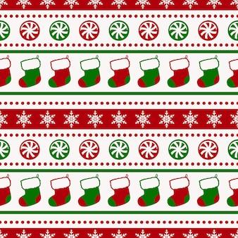 Weihnachtsmuster mit nahtlosem hintergrund der socken und der süßigkeit