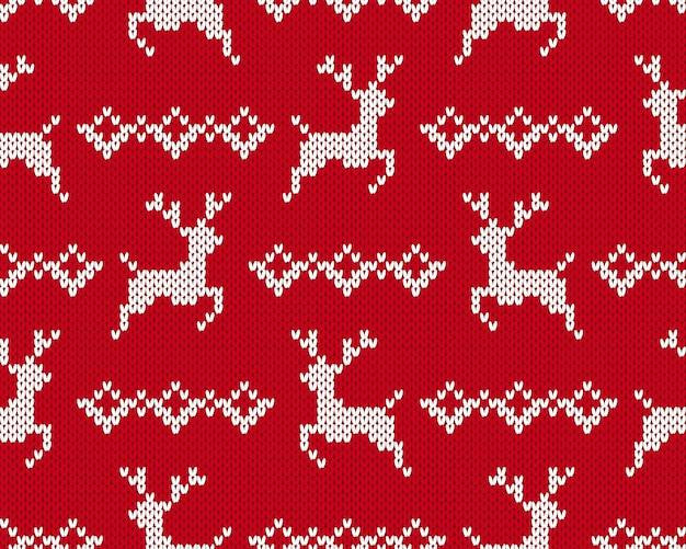 Weihnachtsmuster stricken. nahtloser weihnachtshintergrund mit hirsch. gestrickter pulloverdruck. winter textur.