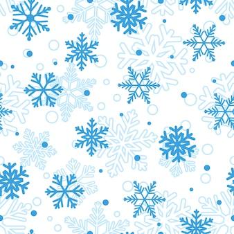 Weihnachtsnahtloses muster aus großen und kleinen schneeflocken, blau auf weiß