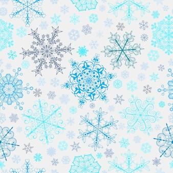 Weihnachtsnahtloses muster aus großen und kleinen schneeflocken, blau und hellblau auf weiß