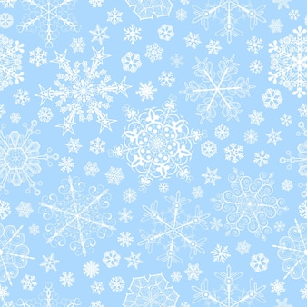 Weihnachtsnahtloses muster aus großen und kleinen schneeflocken, weiß auf hellblau