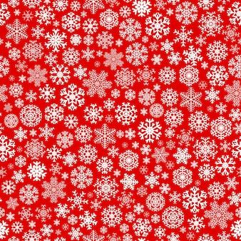 Weihnachtsnahtloses muster aus weißen schneeflocken auf rotem hintergrund