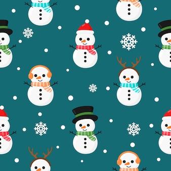 Weihnachtsnahtloses muster mit dem schneemann getrennt auf blau