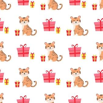 Weihnachtsnahtloses muster mit süßem tiger und geschenken