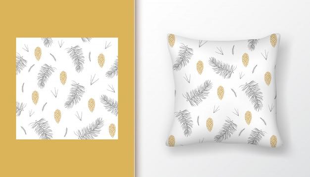 Weihnachtsnahtloses muster mit tannenbaumasten und goldenen kiefernkegeln auf kissen verspotten oben.