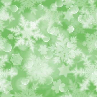 Weihnachtsnahtloses muster mit weißen unscharfen schneeflocken, blendung und funkeln auf grünem hintergrund