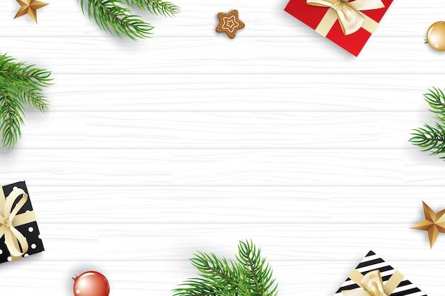 Weihnachtsrahmen mit kopienraum für text auf weißem hölzernem hintergrund.