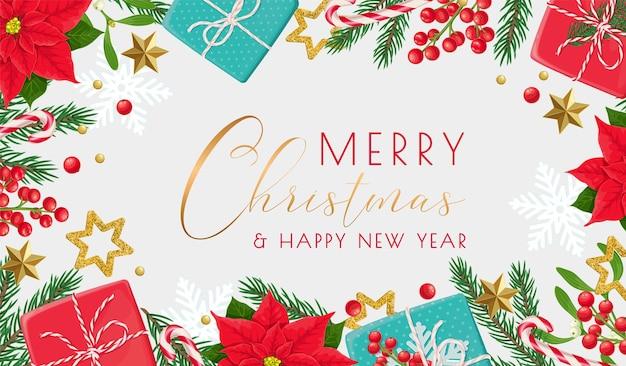 Weihnachtsrahmenschablone mit geschenk, fichtenzweigen, weihnachtsstern, weihnachtsverzierung und stechpalmenbeeren.