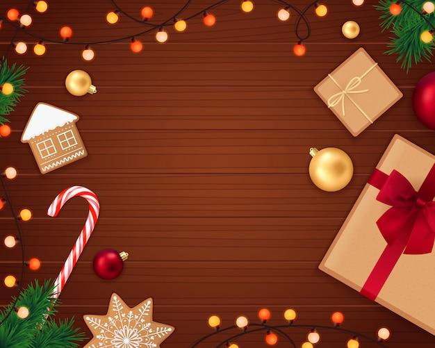 Weihnachtsrealistische zusammensetzung mit hölzernem hintergrund