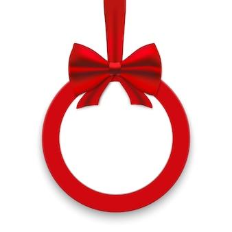 Weihnachtsrunde papierkarte mit roten bändern und satinbögen.