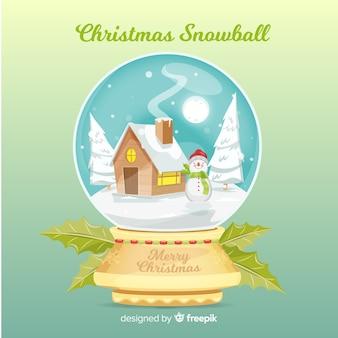 Weihnachtsschneeball mit haus