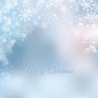 Weihnachtsschneeflocken verwischten hintergrund