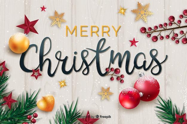 Weihnachtsschriftzug mit realistischen elementen