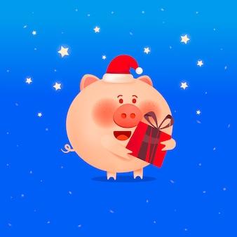 Weihnachtsschwein mit einem geschenk. das jahr des schweins feiertagsgrußkarte