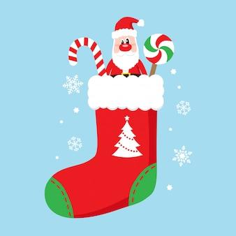 Weihnachtssocke mit süßigkeiten und santa claus
