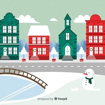 Weihnachtsstadthintergrund im flachen design