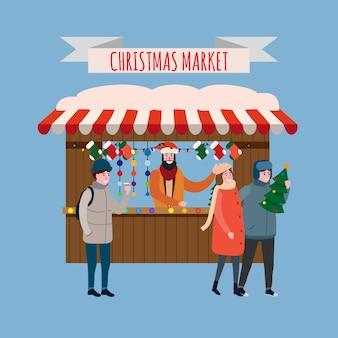 Weihnachtsstand mit mit souvenirs und geschenkladen mit girlandendekorationen