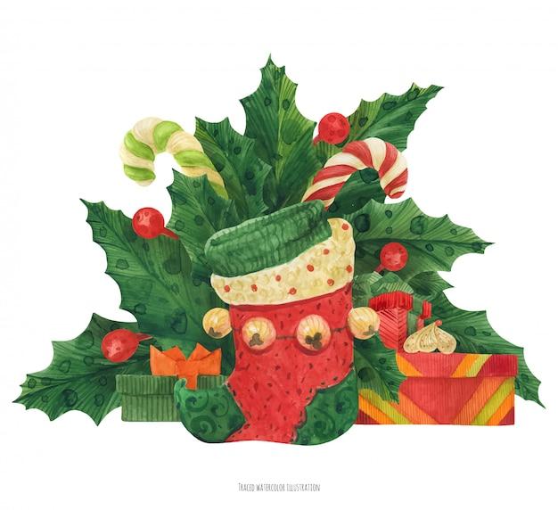 Weihnachtsstechpalmenblumenstrauß mit elfenstrumpf und geschenke und zuckerstangen