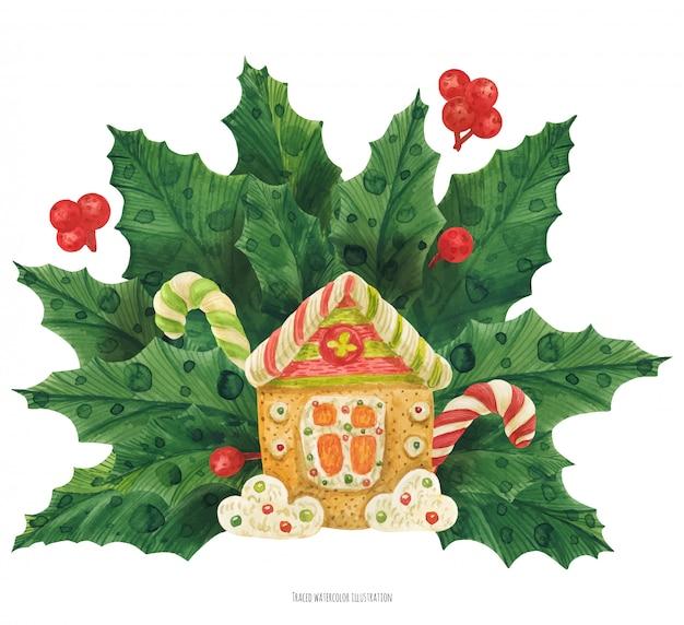 Weihnachtsstechpalmenblumenstrauß mit lebkuchenhaus