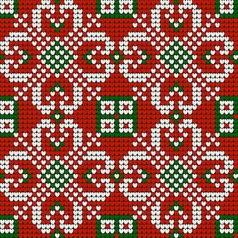 Weihnachtsstrickmuster der großmutter in den roten, grünen und weißen farben