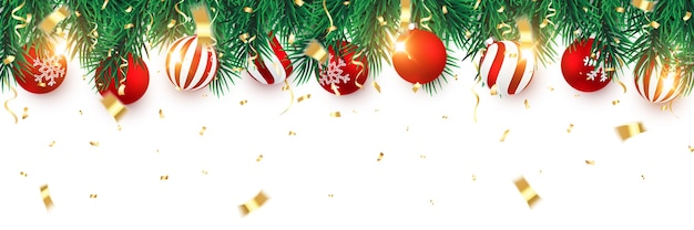 Weihnachtstannenzweige mit konfetti und weihnachtlichen roten kugeln