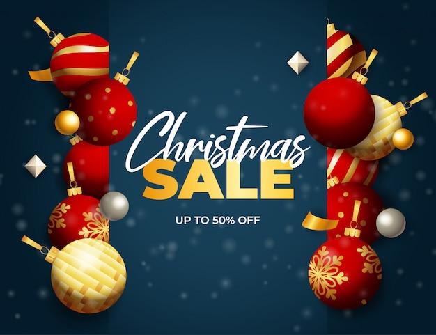 Weihnachtsverkaufsfahne mit bällen und flocken auf blauem boden