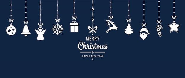 Weihnachtsverzierungselemente, die blauen hintergrund hängen