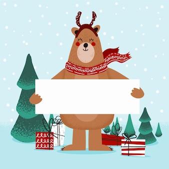 Weihnachtszeichenbär, der unbelegte fahne anhält