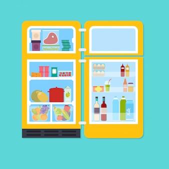 Weinlese gelber offener kühlschrank voll von frischem obst und gemüse, fleisch. koch- und küchenkonzept.