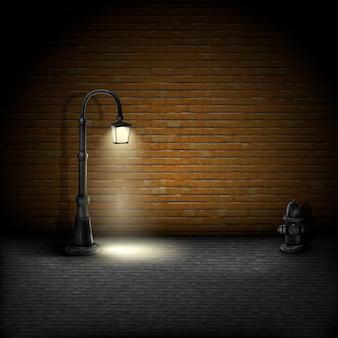 Weinlese-straßenbeleuchtung auf backsteinmauer-hintergrund.